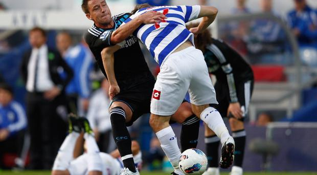 LONDON, ENGLAND - OCTOBER 23: John Terry of Chelsea grapples Tommy Smith of Queens Park Rangers to the ground during the Barclays Premier League match between Queens Park Rangers and Chelsea at Loftus Road on October 23, 2011 in London, England. (Photo by Paul Gilham/Getty Images)