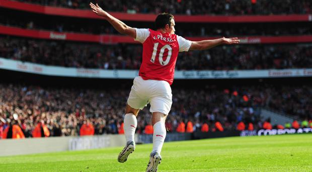 LONDON, ENGLAND - OCTOBER 23: Robin Van Persie of Arsenal celebrates scoring during the Barclays Premier League match between Arsenal and Stoke City at the Emirates Stadium on October 23, 2011 in London, England. (Photo by Jamie McDonald/Getty Images)