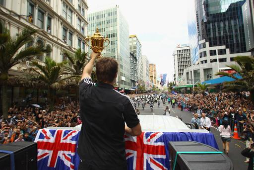 AUCKLAND, NEW ZEALAND - OCTOBER 24: All Black Captain Richie McCaw holds up the Webb Ellis Cup during the New Zealand All Blacks 2011 IRB Rugby World Cup celebration parade on October 24, 2011 in Auckland, New Zealand. The All Blacks won the 2011 RWC Final last night by defeating France 8-7 at Eden Park. (Photo by Phil Walter/Getty Images)