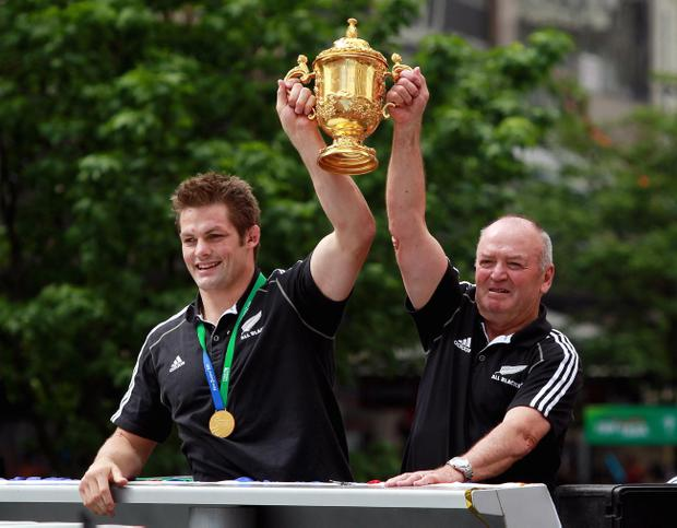 New Zealand's Richie McCaw (left) and coach Graham Henry (right) hold the World Cup aloft during the victory parade in Auckland, New Zealand