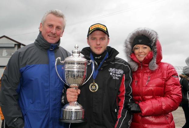 Ian Lowry with mum Helen and dad Rodney after his triple success in Sunflower Trophy races at Bishopscourt