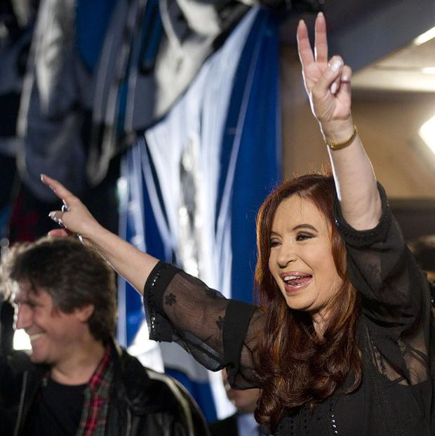 Argentina's president Cristina Fernandez gestures to supporters at the Plaza de Mayo square in Buenos Aires (AP)