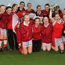 The Ulster under-18 girls celebrate their victory in the Interprovincial championship, which they secured at Stormont yesterday with a convincing 3-0 win over Leinster