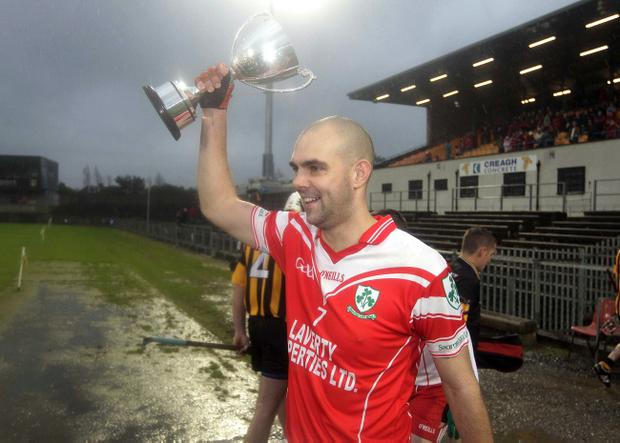 Loughgiel Shamrocks skipper Johnny Campbell proudly displays the trophy after his side claimed the Ulster Senior Club hurling title yesterday
