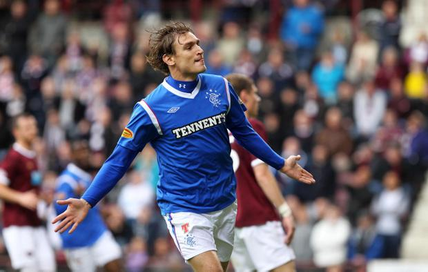 Rangers' Nikica Jelavic celebrates scoring his side's second goal during the Clydesdale Bank Scottish Premier League match at Tynecastle Stadium, Edinburgh