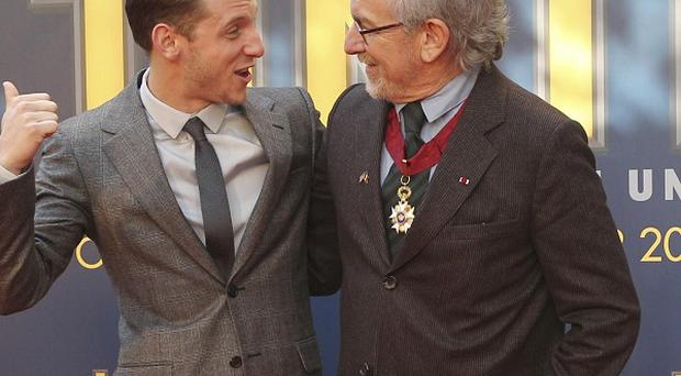 Steven Spielberg and Jamie Bell pose on the red carpet ahead of the world premiere of the Tintin movie
