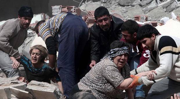 People rescue two women trapped under debris after a 7.2-magnitude earthquake struck eastern Turkey (AP Photos)