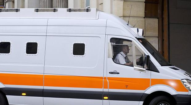 The prison van carrying Vincent Tabak, the man accused of the murder of Joanna Yeates, arrives at Bristol Crown Court