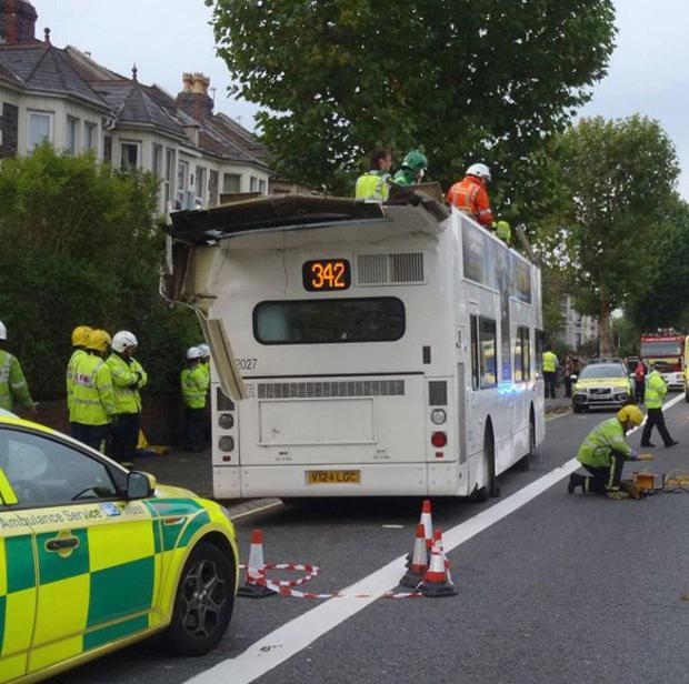 Eighteen people were injured after the roof of a double-decker bus was torn off in Bristol