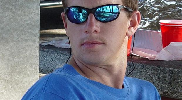 George Thomas Wainwright was fatally attacked on Saturday while diving (AP)