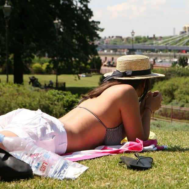 Sunbathing in the morning could reduce the risk of skin cancer according to new research