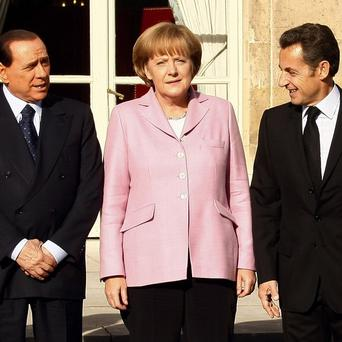 Italian Prime Minister Silvio Berlusconi, German Chancellor Angela Merkel and French President Nicolas Sarkozy (AP Photo/Michel Spingler, File)