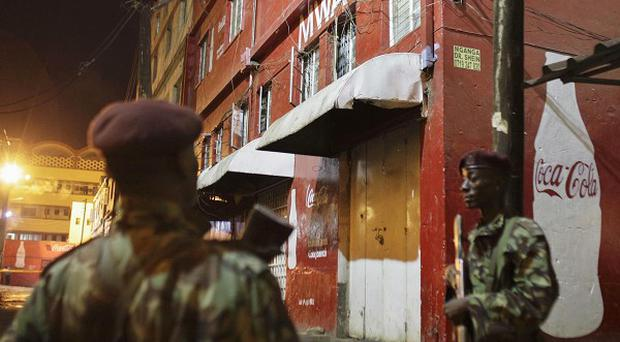 Kenyan police guard the scene of a suspected grenade blast at a pub in Nairobi (AP)