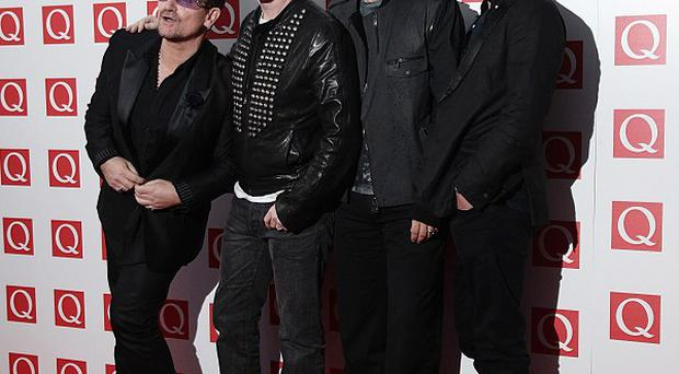 U2 have been voted top rock act of the past 25 years by readers of music magazine Q