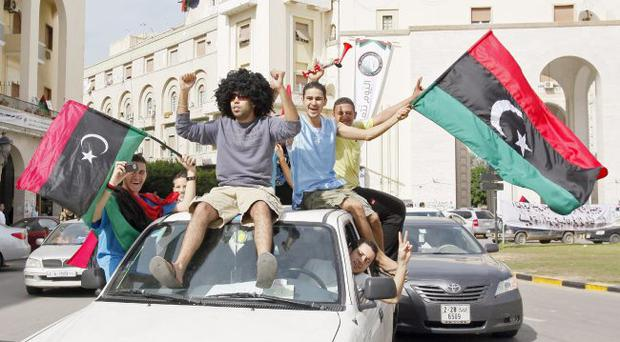 Libyans celebrate Gaddafi's overthrow