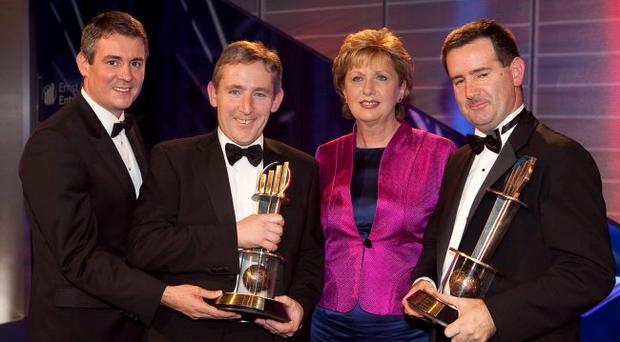 Irish President Mary McAleese carried out one of the final engagements of her presidency when she joined Frank O'Keeffe of Ernst & Young (left) to present the Ernst & Young Entrepreneur of the Year award to Joe Hagan (right) and Niall Norton of software company Openet