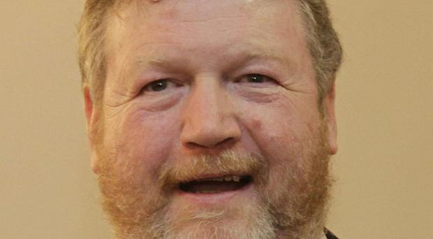 James Reilly aims to introduce universal healthcare and provide a free GP service