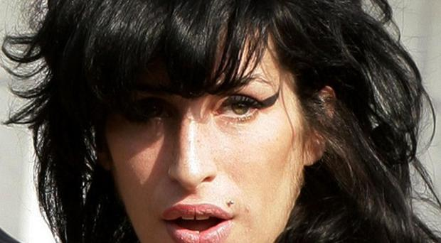 There was a mix-up over papers relating to Amy Winehouse's inquest, police say