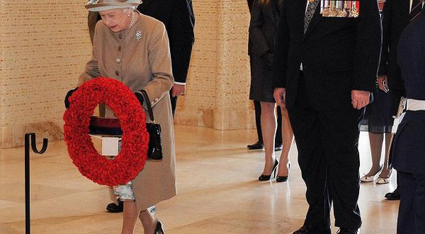 The Queen lays a wreath at the Tomb of the Unknown Solider in Canberra