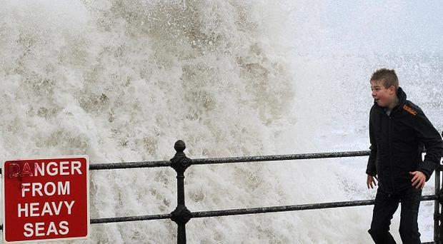Holiday-makers get caught by the high waves in North Bay, Scarborough