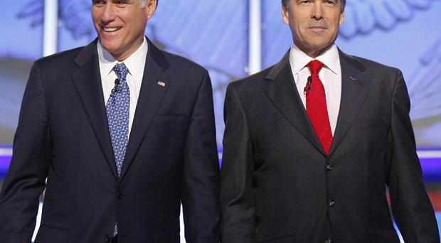Rival Republican presidential candidates Mitt Romney, left, and Rick Perry(AP)