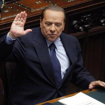 Silvio Berlusconi rounded on Germany and France over the Italian economy
