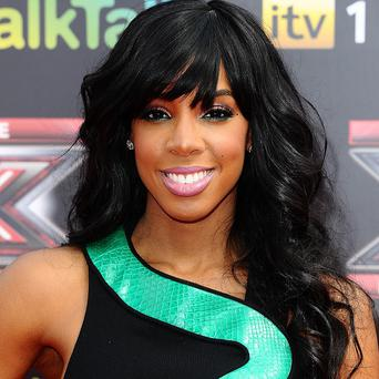Kelly Rowland has flown back to the US on business