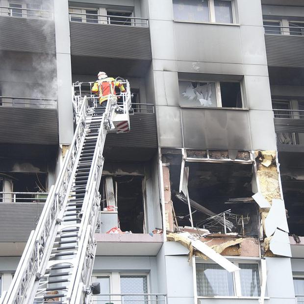 Firefighters try to extinguish the fire in an apartment building in Yverdon-les-Bains (AP)