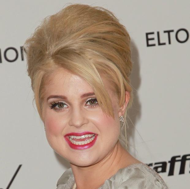 Kelly Osbourne has hit out at a fake Amy Winehouse Twitter account