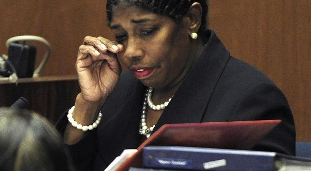 Cherilyn Lee wipes her eyes during testimony at the Conrad Murray involuntary manslaughter trial in Los Angeles (AP)
