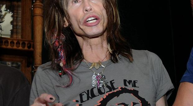 Aerosmith singer Steven Tyler lost two teeth in a fall in his hotel bathroom (AP)