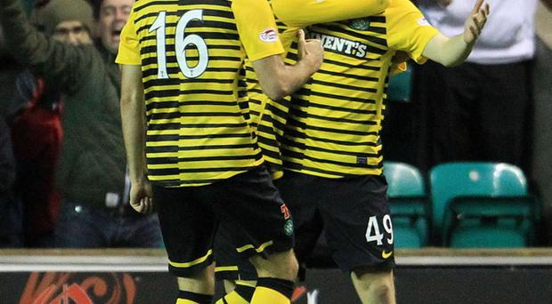 Celtic's James Forrest (right) celebrates the first of his two goals against Hibernian last night