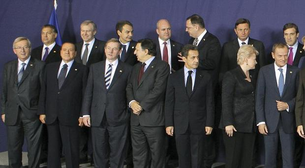 Taoiseach Enda Kenny, front row, third from left, with fellow EU leaders at the summit in Brussels (AP)