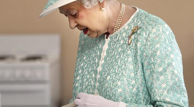 The Queen looks at samples of food prepared by students at Clontarf Aboriginal College in Perth, Australia (AP)
