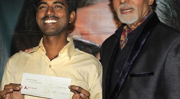 Sushil Kumar, left, poses with Amitabh Bachchan, in Mumbai, after his win (AP)