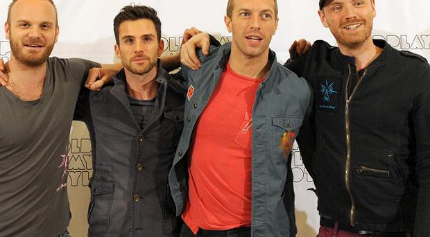 Coldplay have told how they tried to write songs under hypnosis