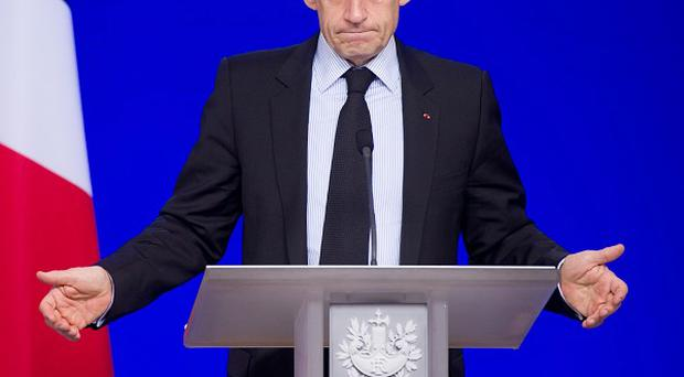 French President Nicolas Sarkozy said the country's growth projection would be reduced to one per cent in 2012 (AP)
