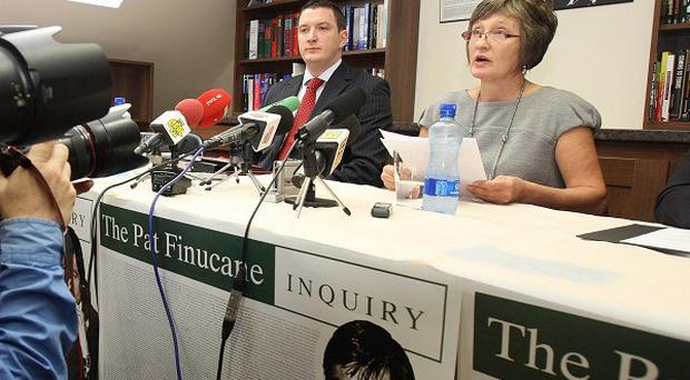 Geraldine Finucane and her son John at a press conference in Belfast