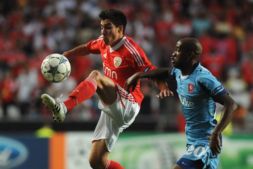 Benfica's Nicolas Gaitan (left), rated at around £35m, is a top target for Manchester United after starring against Sir Alex Ferguson's side in Europe