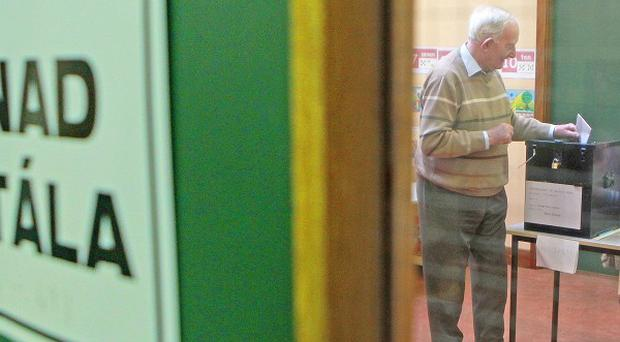 Ned Cusack, 92, casts his vote in the polling station in west Galway