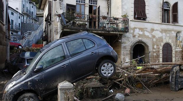 The muddy aftermath of floods in Borghetto Di Vara, in the region of Liguria, Italy (AP)