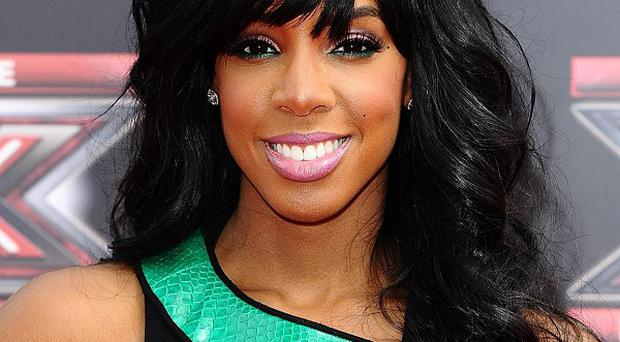 Kelly Rowland will be missing from the X Factor juding panel