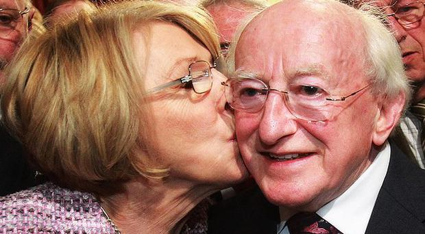 Labour candidate Michael D Higgins receives a kiss from his wife Sabina Coyne