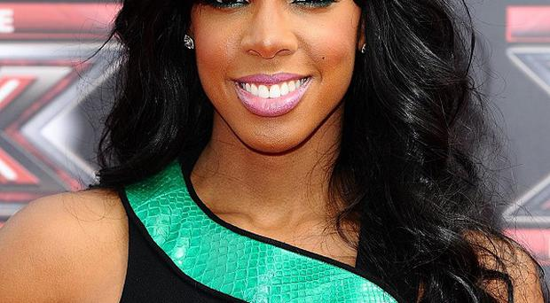 Kelly Rowland is said to be too ill to fly back from the US for this weekend's X Factor
