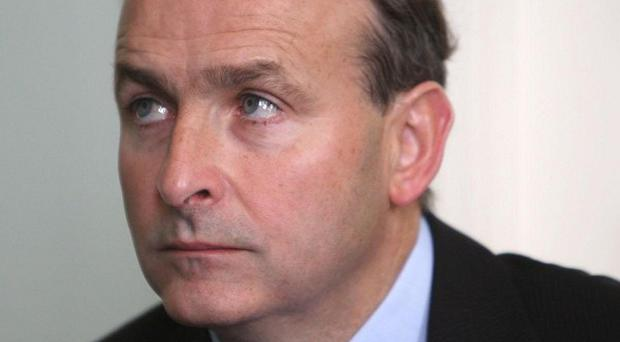 Fianna Fail leader Micheal Martin said Labour's Michael D Higgins would be 'an excellent president and ambassador for Ireland'