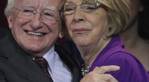 President-elect, Michael D Higgins, is hugged by his wife Sabina after his election victory is announced at Dublin Castle