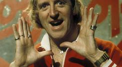 Jimmy Savile - pictured here presenting the BBC's Top of the Pops in 1976