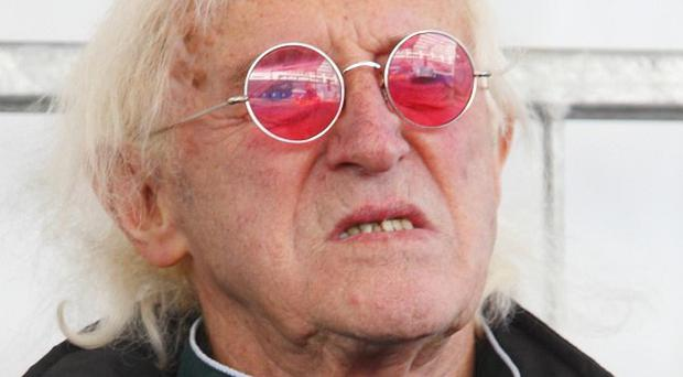 Broadcaster and DJ Sir Jimmy Savile, pictured in 2010, has died aged 84