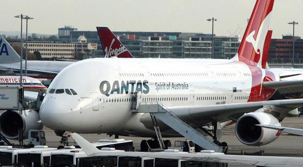 A Qantas plane sits on the tarmac at Heathrow as hundreds of passengers were left stranded