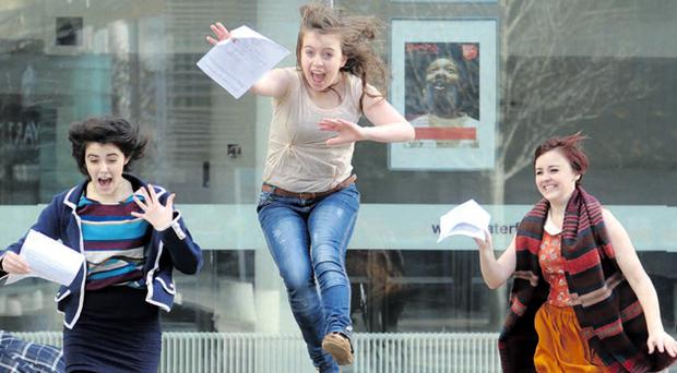 Lauren Coleman, Emma Toner and Shannon Coleman jump for joy outside the Waterfront Hall